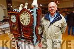 Well known clockmaker Tim Brown from Ballyduff admiring the old clocks at the Antique Fair in the Ballygarry House Hotel on Sunday.