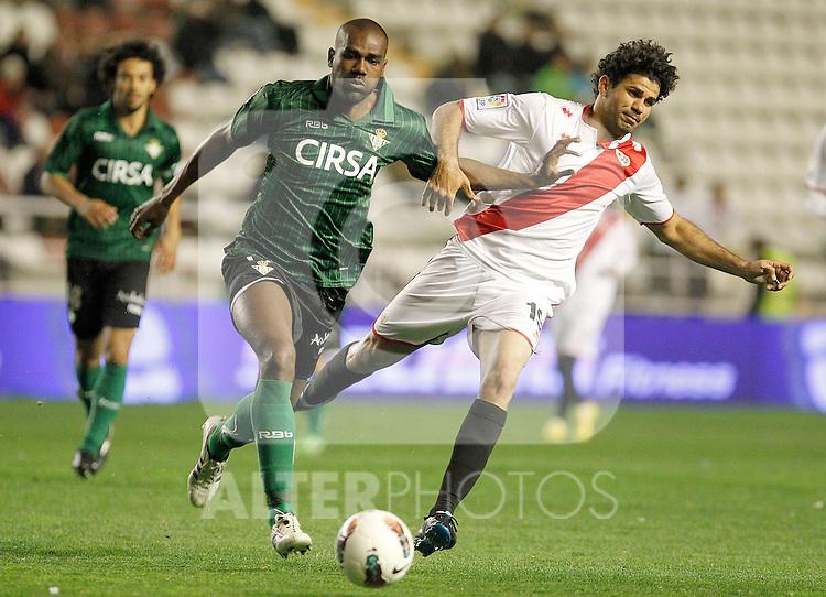 Rayo Vallecano's Diego Costa (r) and Betis' Paulao during La Liga match.March 17,2012. (ALTERPHOTOS/Acero)