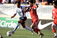 Charlie Davies holds off China's Zhang Yaokun (4). The USA defeated China, 4-1, in an international friendly at Spartan Stadium, San Jose, CA on June 2, 2007.