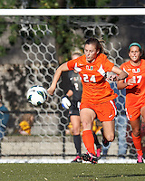 University of Miami defender Tara Schwitter (24) brings the ball forward. .After two overtime periods, Boston College (gold) tied University of Miami (orange), 0-0, at Newton Campus Field, October 21, 2012.