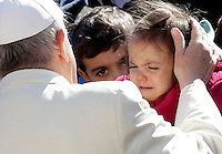 Papa Francesco saluta alcuni bambini al suo arrivo all'udienza generale del mercoledi' in Piazza San Pietro, Citta' del Vaticano, 8 aprile 2015.<br /> Pope Francis greets children as he arrives for his weekly general audience in St. Peter's Square at the Vatican, 8 April 2015.<br /> UPDATE IMAGES PRESS/Riccardo De Luca<br /> <br /> STRICTLY ONLY FOR EDITORIAL USE
