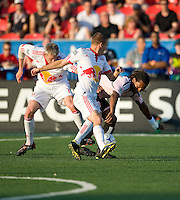 24 June2009: New York Red Bulls midfielder Seth Stammler #6 and Toronto FC defender Adrian Serioux #15 in action at BMO Field in Toronto, in a game between the New York Red Bulls and Toronto FC. Toronto FC won 2-0..