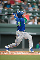 SHortstop Cristian Perez (15) of the Lexington Legends follows through on a swing during a game against the Greenville Drive on Sunday, September 2, 2018, at Fluor Field at the West End in Greenville, South Carolina. Greenville won, 7-4. (Tom Priddy/Four Seam Images)