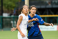 TACOMA, WA - JULY 31: Yuki Nagasato #17 of Racing Louisville FC and Dzsenifer Marozsan #8 of the OL Reign look on during a game between Racing Louisville FC and OL Reign at Cheney Stadium on July 31, 2021 in Tacoma, Washington.
