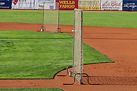 The safety fences sit idle as the grounds crew prepares the field when the Ogden Raptors faced the Orem Owlz in Pioneer League play at Lindquist Field on August 28, 2013 in Ogden Utah.  (Stephen Smith/Four Seam Images)