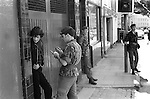 Derry Northern Ireland Londonderry. 1979. British Army taking details of Catholic man in street.