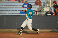 Christian Maggio (31) (Charleston Southern) of the Mooresville Spinners follows through on his swing against the Dry Pond Blue Sox at Moor Park on July 2, 2020 in Mooresville, NC.  The Spinners defeated the Blue Sox 9-4. (Brian Westerholt/Four Seam Images)