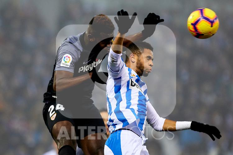CD Leganes' Youssef En-Nesyri and Sevilla FC's Joris Gnagnon during La Liga match between CD Leganes and Sevilla FC at Butarque Stadium in Leganes, Spain. December 23, 2018. (ALTERPHOTOS/A. Perez Meca)