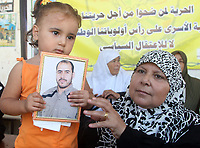 """A Palestinian child attends a protest calling for the release of Palestinian prisoners from Israel jails, in Gaza August 6, 2007. Israeli Prime Minister Ehud Olmert will meet Palestinian President Mahmoud Abbas in the West Bank on Monday, opening talks on broad """"principles"""" for a Palestinian state ahead of a conference later in the year.""""photo by Fady Adwan"""""""