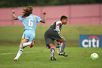 Philadelphia goalkeeper, Karina LeBlanc (23) shields the ball from onrushing New Jersey forward, Natasha Kai (6).  After a nearly two hour rain delay, Sky Blue FC defeated the Philadelphia Independence on a second half goal by Yael Averbuch in a game played at Yurcak Field on the Rutgers University Campus in Piscataway, NJ.