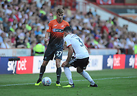 Swansea City's Jay Fulton vies for possession with Sheffield United's Enda Stevens during the Sky Bet Championship match between Sheffield United and Swansea City at Bramall Lane, Sheffield, England, UK. Saturday 04 August 2018