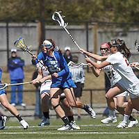 Duke University defender Taylor Virden (23) comes away with ball after initial draw.Boston College (white) defeated Duke University (blue), 10-9, on the Newton Campus Lacrosse Field at Boston College, on April 6, 2013.