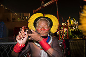Imperatriz Leopolinense Samba School, Carnival, Rio de Janeiro, Brazil, 26th February 2017. Chief Raoni Metuktire enjoys a pipe after the procession.