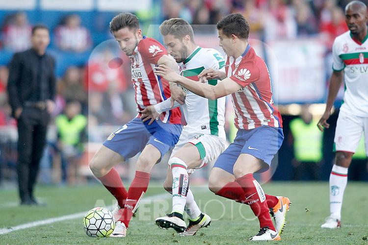 Atletico de Madrid's Saul Niguez (l) and Lucas Hernandez (r) and Granada Club de Futbol's Ruben Rochina during La Liga match. April 17,2016. (ALTERPHOTOS/Acero)