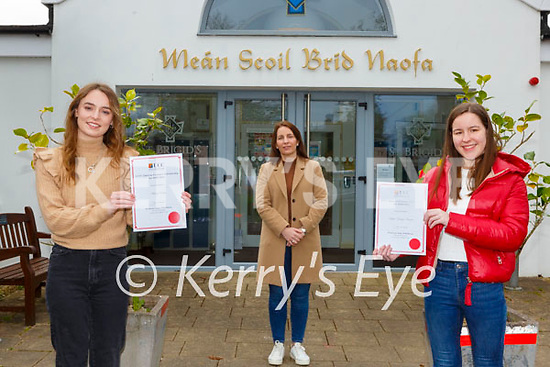 Roisin Moore Principal with former St Brigid's Presentation school students Aisling Reidy left and Sophie Vousden who have received A UCC Quercus Entrance Scholarship for 2020/21 on Tuesday
