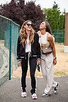 TACOMA, WA - JULY 31: Sofia Huerta #11 and Ally Watt #7 of the OL Reign arrive at the stadium before a game between Racing Louisville FC and OL Reign at Cheney Stadium on July 31, 2021 in Tacoma, Washington.