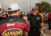 May 1, 2011; Baytown, TX, USA: NHRA top fuel dragster driver Del Worsham celebrates with team owner Alan Johnson after winning the Spring Nationals at Royal Purple Raceway. Mandatory Credit: Mark J. Rebilas-