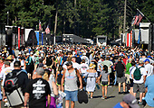 Race fans walk the nitro pits at the NHRA Northwest Nationals.
