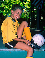 Girl getting ready for a soccer game.