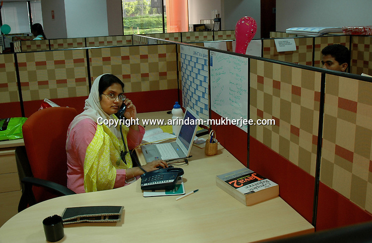 An Indian lady at work in Infosys, Bangalore. Infosys is the largest software company in the country and the head office is in Bangalore, Karnataka, India. Arindam Mukherjee