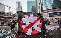 Pro-democracy protesters hold a banner saying 'No Communict Party' during the first day of the mass civil disobedience campaign Occupy Central, Hong Kong, China, 28 September 2014.