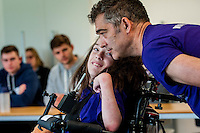 COPY BY TOM BEDFORD<br /> Pictured: Poppy tand dad Rob talk to students at the university to help them understand here challenges Sunday 26 June 2016<br /> Re: A very special father-and-daughter team have tackled the Cardiff Triathlon.<br /> Poppy Jones, 11, who will be competing alongside dad Rob Jones, wants to win the event.<br /> And she's not going to let the fact that she has quadriplegic cerebral palsy , which means she can't sit, stand, roll or support herself, and chronic lung disease stop her.<br /> She will be by Rob's side every step of the way thanks to a cutting-edge wheelchair and boat – for Rob to push or pull – designed especially for the event, which sees participants take part in a swim across Cardiff Bay , a run and a bike ride.