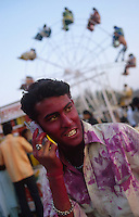 "Südasien Asien Indien IND Bombay Mumbai .indisches Fruehlingsfest Holi , Menschen bespruehen bespritzen bewerfen sich mit Farbe Farbpuder , junger Mann mit Reliance Mobiltelefon am Juhu Beach -  Fest Feste Festival Inder indisch xagndaz | .South Asia India Bombay Mumbai .indian spring festival Holi , people throw color and powder  -  man with mobile phone at Juhu Beach .| [ copyright (c) Joerg Boethling / agenda , Veroeffentlichung nur gegen Honorar und Belegexemplar an / publication only with royalties and copy to:  agenda PG   Rothestr. 66   Germany D-22765 Hamburg   ph. ++49 40 391 907 14   e-mail: boethling@agenda-fototext.de   www.agenda-fototext.de   Bank: Hamburger Sparkasse  BLZ 200 505 50  Kto. 1281 120 178   IBAN: DE96 2005 0550 1281 1201 78   BIC: ""HASPDEHH"" ,  WEITERE MOTIVE ZU DIESEM THEMA SIND VORHANDEN!! MORE PICTURES ON THIS SUBJECT AVAILABLE!! INDIA PHOTO ARCHIVE: http://www.visualindia.net ] [#0,26,121#]"