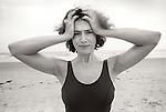 1978. Brigantine beach, NJ. Cate looking perplexed on beach.