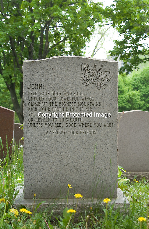 """A headstone in Notre-Dame-des-Neiges Cemetery in Montreal, Quebec, Canada belongs to John Laird McCaffrey, who died in 1995 at the age of 54. By forming an acrostic using the first letter of each line, a secret message is revealed: """"FUCK YOU."""""""