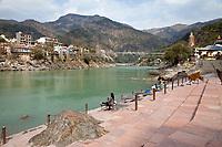India, Rishikesh.  Practitioner of Yoga at an Ashram alongside River Ganges (Ganga).