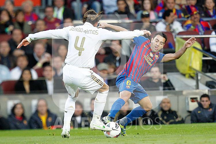 Barcelona's Xavi Hernandez and Real Madrid's Sergio Ramos during la liga match on april 21st 2012...Photo: Cesar Cebolla / ALFAQUI