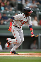 Third baseman Jean Carlos Encarnacion (14) of the Rome Braves bats in a game against the Greenville Drive on Saturday, April 14, 2018, at Fluor Field at the West End in Greenville, South Carolina. Rome won, 4-0. (Tom Priddy/Four Seam Images)