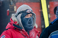 Dog mushers in the chilly minus 40 degree temperatures at the start of the 2008 Yukon Quest sled dog race in Fairbanks, Alaska.