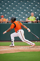 Bowie Baysox left fielder Ademar Rifaela (1) follows through on a swing during the first game of a doubleheader against the Trenton Thunder on June 13, 2018 at Prince George's Stadium in Bowie, Maryland.  Trenton defeated Bowie 4-3.  (Mike Janes/Four Seam Images)