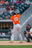 Dariel Alvarez (10) of the Norfolk Tides at bat against the Charlotte Knights at BB&T BallPark on April 9, 2015 in Charlotte, North Carolina.  The Knights defeated the Tides 6-3.   (Brian Westerholt/Four Seam Images)