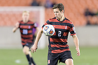 Houston, TX - Friday December 9, 2016: Foster Langsdorf (2) of the Stanford Cardinal gains control of a loose ball against the North Carolina Tar Heels at the NCAA Men's Soccer Semifinals at BBVA Compass Stadium in Houston Texas.