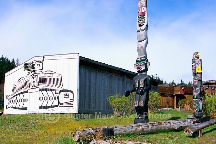 U'mista Cultural Centre and Kwakwaka'wakw (Kwakiutl) Totem Poles, Alert Bay, Cormorant Island, BC, British Columbia, Canada - Man holding Copper stands atop Dzoonokwa (Wild Woman of Woods) (left), Thunderbird sits atop Killer Whale (right)