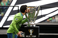 SEATTLE, WA - NOVEMBER 10: Victor Rodriguez #8 of the Seattle Sounders FC kisses the Philip F. Anschutz Trophy after receiving his MLS Cup MVP trophy during a game between Toronto FC and Seattle Sounders FC at CenturyLink Field on November 10, 2019 in Seattle, Washington.