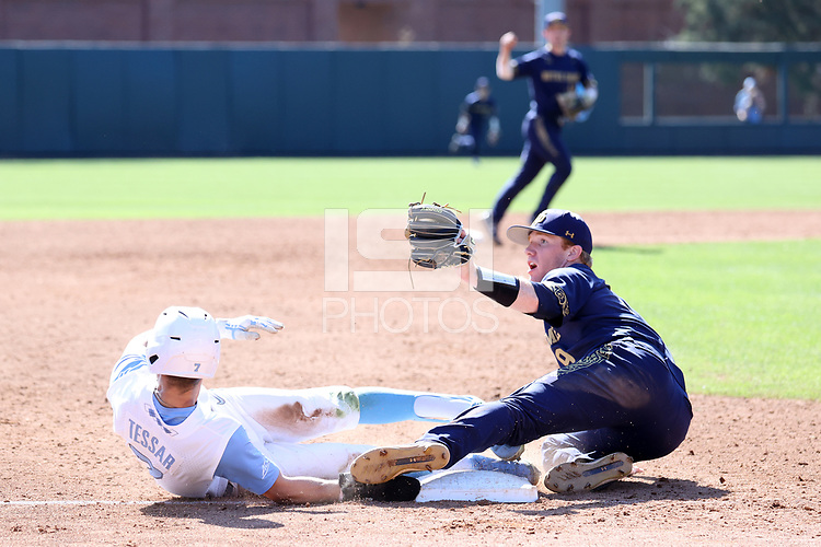CHAPEL HILL, NC - MARCH 08: Eric Gilgenbach #25 of the University of Notre Dame looks to the umpire after tagging out Dallas Tessar #7 of the University of North Carolina at third base during a game between Notre Dame and North Carolina at Boshamer Stadium on March 08, 2020 in Chapel Hill, North Carolina.