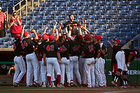 Houston Cougars (40) Ryan Hernandez lifts Brad Burckel (5) in the center of his teammates after hitting a home run during a game against the Tulane Green Wave on May 25, 2021 at BayCare Ballpark in Clearwater, Florida.  Tulane defeated Houston 4-1 in the opening game of the American Athletic Conference Tournament.  (Mike Janes/Four Seam Images)