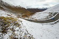 Motorists made their way over Hatcher Pass with fresh termination dust surrounding the road on the last day it was open. The road over the pass is closed to vehicle traffic for winter starting Sept. 14 this year.