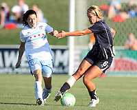 Beverly Goebel #6 of the Washington Freedom pulls the ball away from Karen Carney #14 of the Chicago Red Stars during a WPS match on July 4 2010 at the Maryland Soccerplex, in Boyds, Maryland. The match ended in a 0-0 tie.