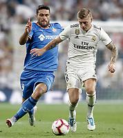 Real Madrid's Toni Kroos (r) and Getafe CF's Jorge Molina during La Liga match. August 19,2018.  *** Local Caption *** © pixathlon<br /> Contact: +49-40-22 63 02 60 , info@pixathlon.de