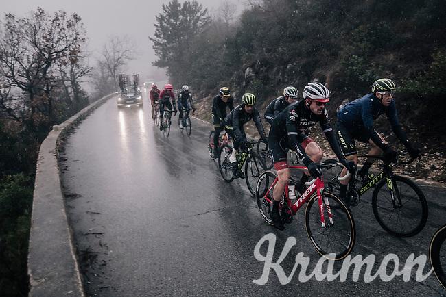 A group with Mathew Hayman (AUS/Michelton-Scott), Gregory Rast (SUI/Trek-Segafredo) & Esteban Chavez (COL/Michelton-Scott) emerge from the mist<br /> <br /> 76th Paris-Nice 2018<br /> Stage 8: Nice > Nice (110km)