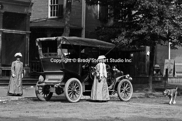 Irwin PA:  Brady Stewart and friends traveled on the Pittsburgh Greensburg Turnpike and stopped off in a town along the way.  The women are sporting new motoring clothes