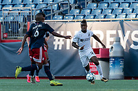 FOXBOROUGH, MA - JULY 25: USL League One (United Soccer League) match. Panzani Ferrety Sousa #25 of Union Omaha brings the ball forward during a game between Union Omaha and New England Revolution II at Gillette Stadium on July 25, 2020 in Foxborough, Massachusetts.