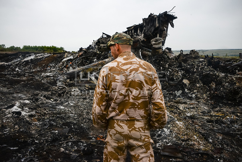 Pro-Russian rebel patrols the crash site of flight MH17 Malaysian Airways Boeing 777, Hrabove, Eastern Ukraine.