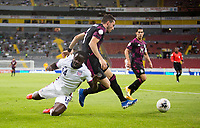 , MEXICO - : Benji Michel #14 of the United States and Manuel Mayorga #3 of Mexico chases down a ball during a game between  and undefined at  on ,  in , Mexico.