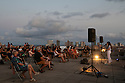 Spain - Barcelona - Barcelonians enjoy a concert on top of the Piramidòn, a center for contemporary art during the festival Musica als Parcs.