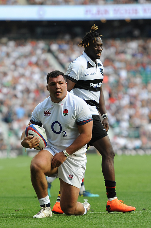 Ellis Genge of England forces his way through Niyi Adeolokun (Connacht & Ireland) of Barbarians to score a try during the Quilter Cup match between England and Barbarians at Twickenham Stadium on Sunday 27th May 2018 (Photo by Rob Munro/Stewart Communications)